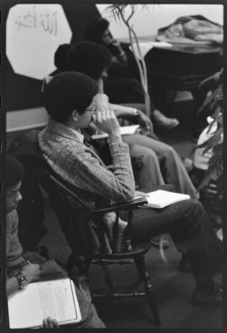 Photographs of an Afro-American Society meeting, a class in session, and scenes of student life, 1975