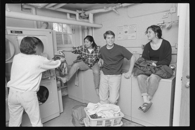 Photographs of students in a laundry room, 1993 April