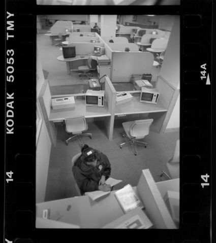 Photographs of students in the media center in Robert Frost Library, October 1995