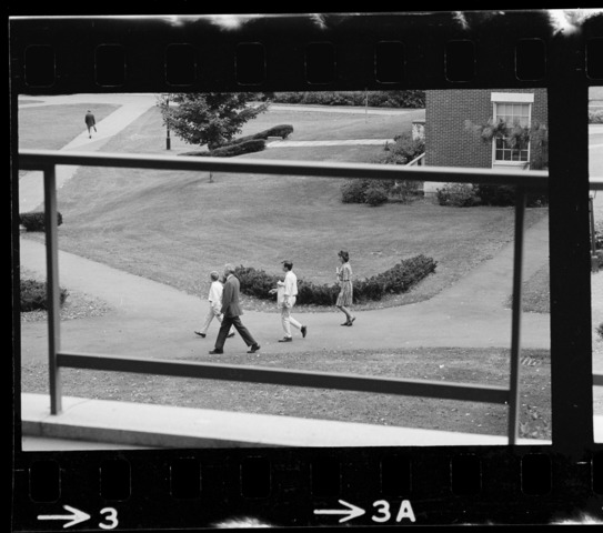 Photographs of freshmen arriving on campus, 1966 September 8