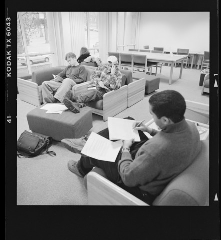 Photographs of students studying in Robert Frost Library, 1998 January