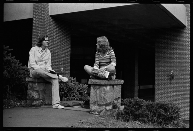 Photographs of students sitting outside of Arms Music Center, 1973 October 11