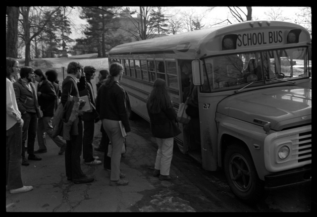 Photographs of students boarding Five College buses, 1973 April